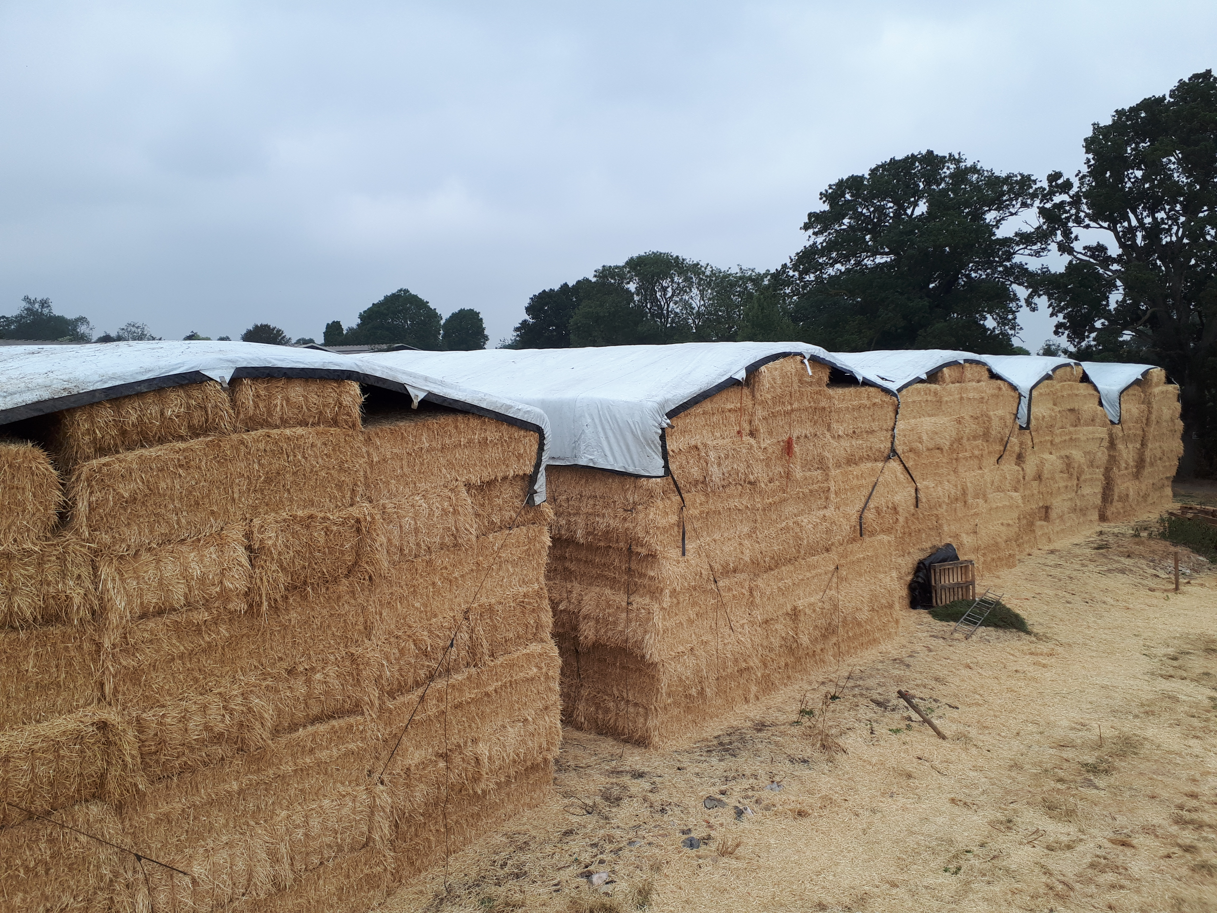 Square bale stack covered with the Performer Tarpaulins